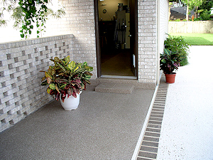 The ColorFlake garage floor epoxy coating has been extended onto the breezeway in this home.