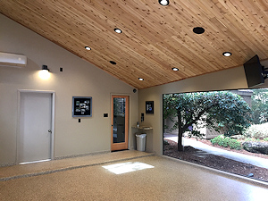 This garage does double duty as a living space extension, and is enhanced by the ColorFlake epoxy floor coating