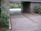 New decorative concrete driveway in Autumn Brown color, with Walnut accents, by Surface Systems of Texas