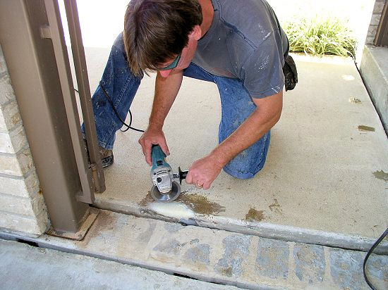hand-grinding a concrete repair, prior to applying ColorFlake expoxy coating