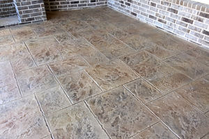 Stamped polymer concrete overlay on a patio